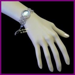 Bracelet du Pérou avec demie-sphère de verre rose irisé