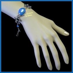 Bracelet du Pérou avec demie-sphère de verre bleu irisé