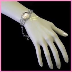 Bracelet du Pérou avec demie-sphère en verre rose pale